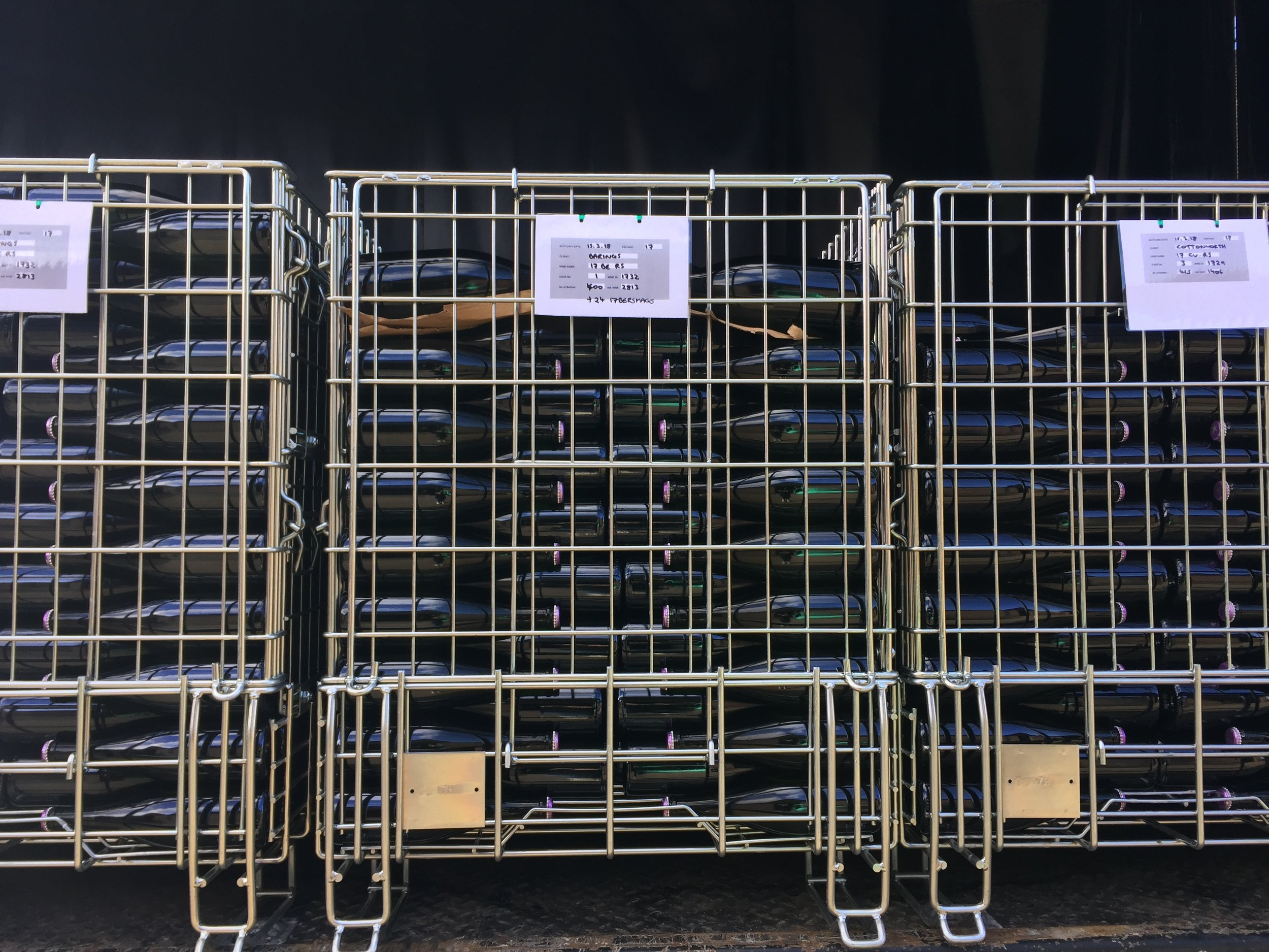 13. Second Fermentation - The bottles are stored in cages in a temperature-controlled room (12-16°C) to undergo their second fermentation in bottle creating the sparkle.