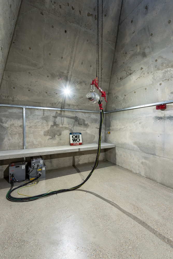 X-ray machine in concrete chamber - the concrete absorbs the radiation
