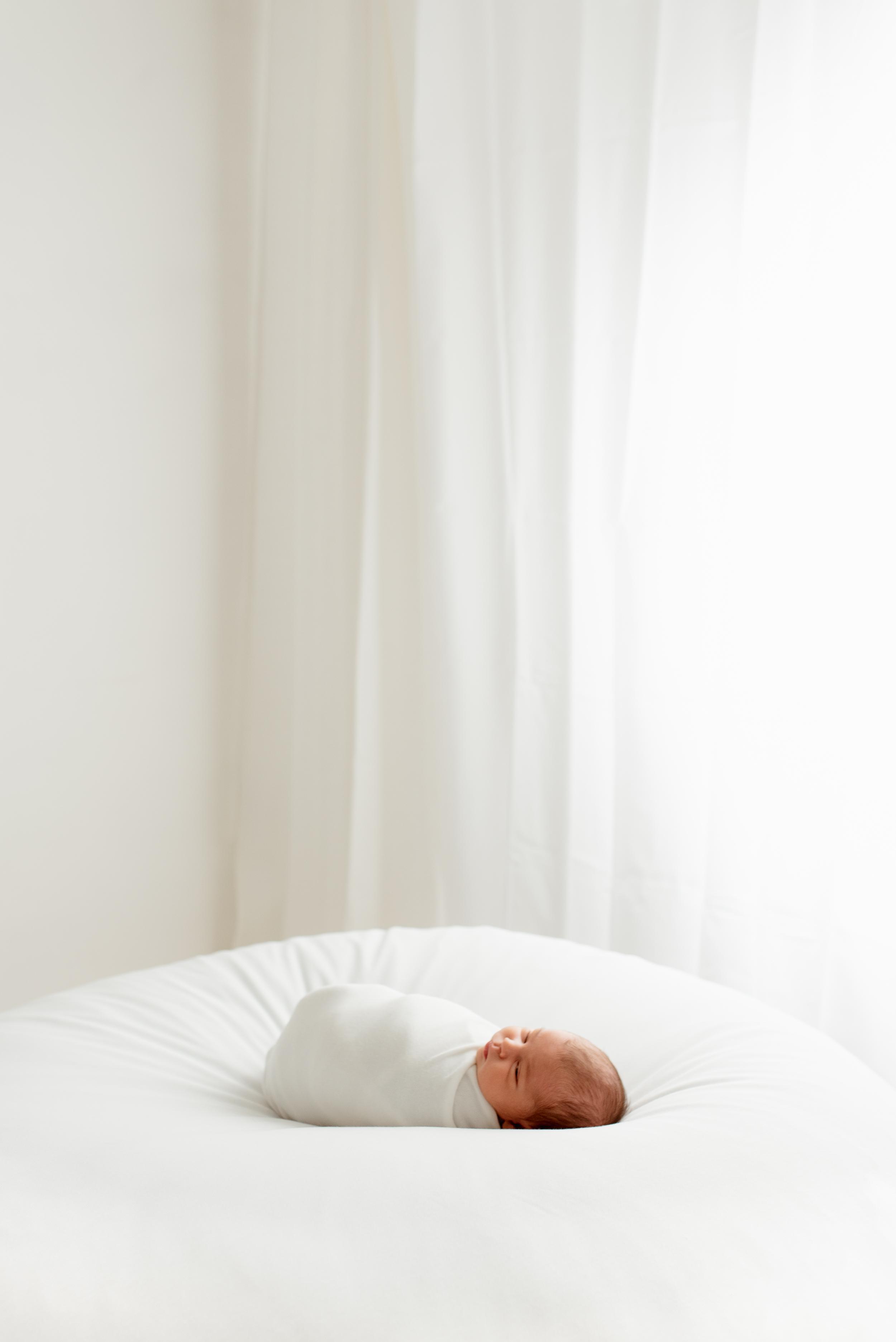 baby girl asleep on white