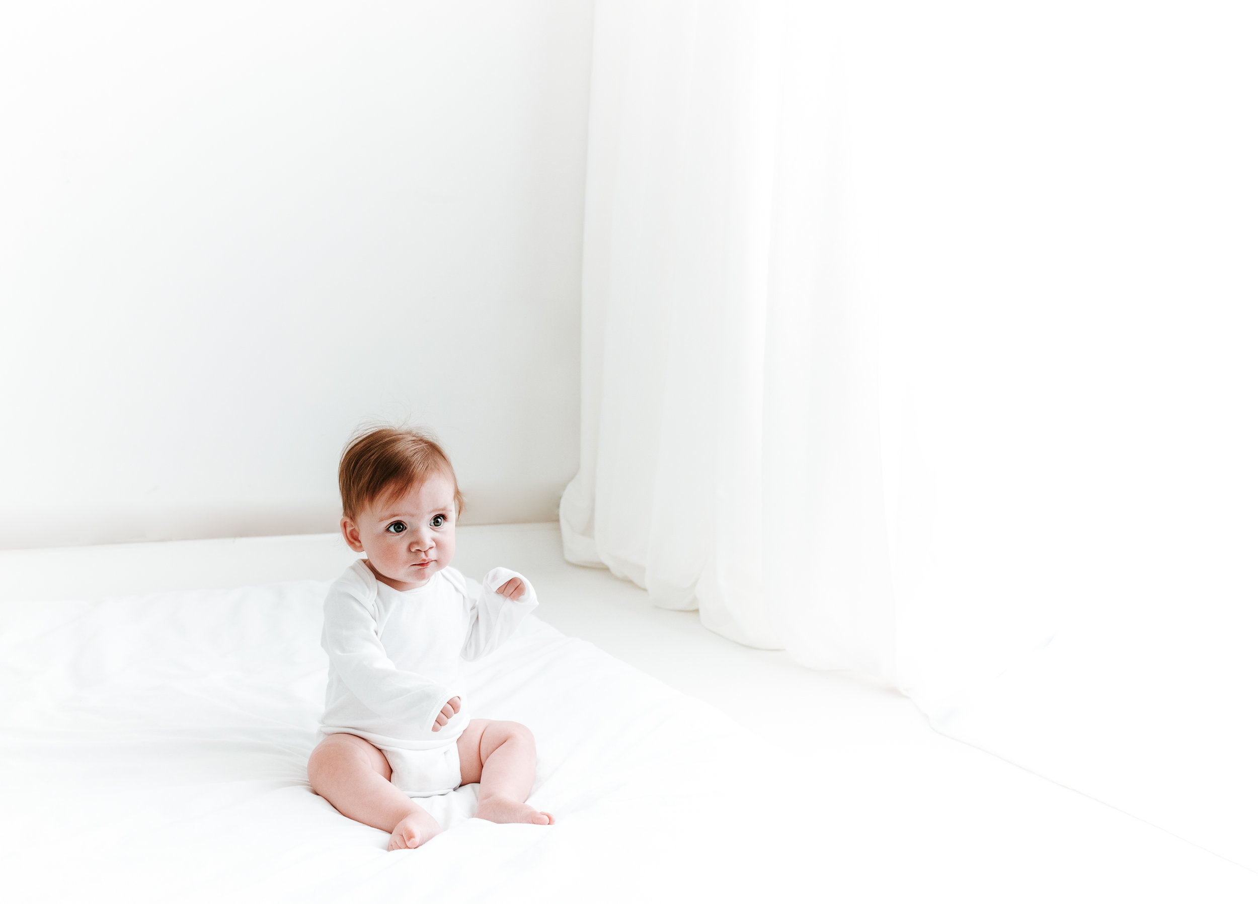 baby looking at Mum in photography studio