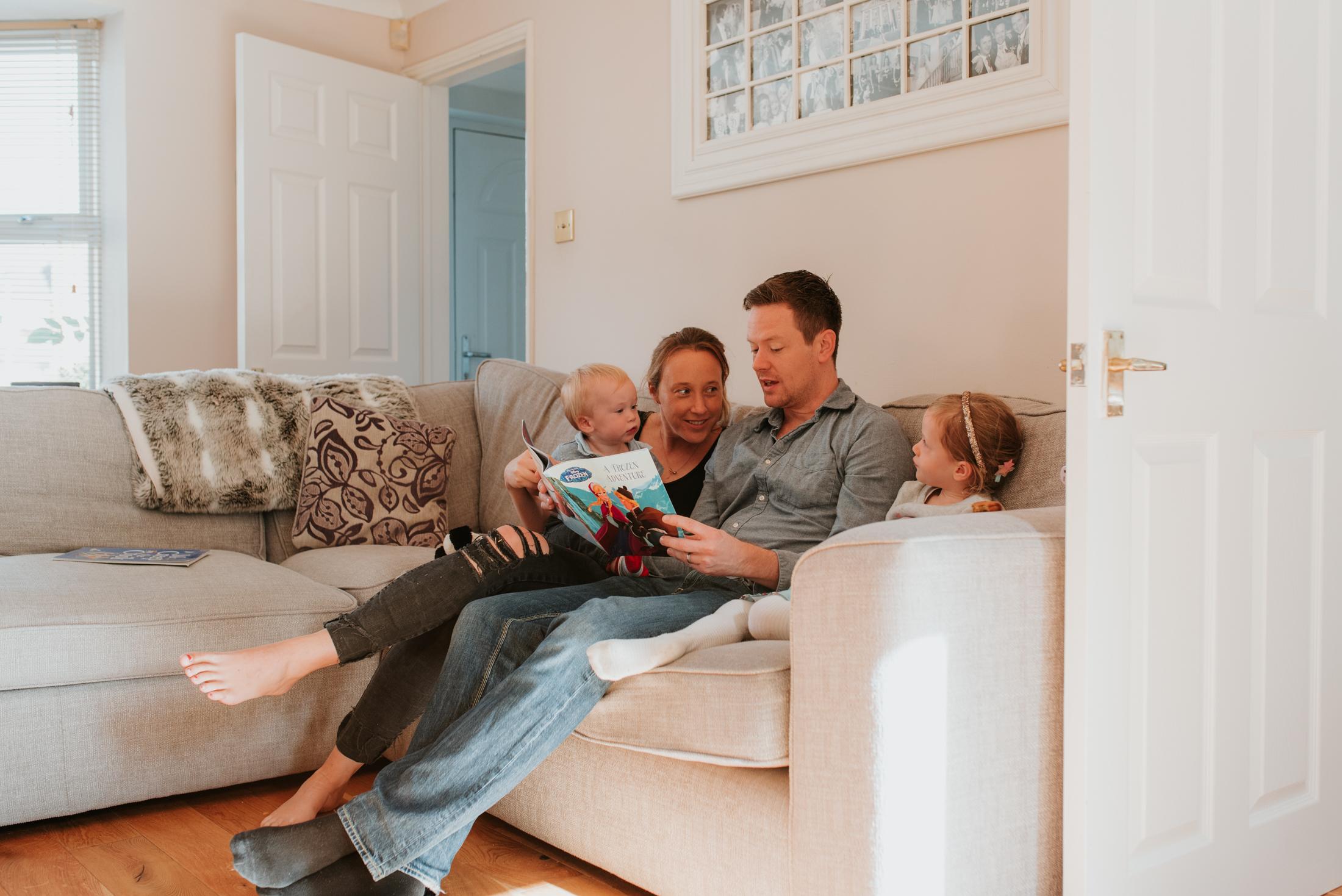 family photo reading a story