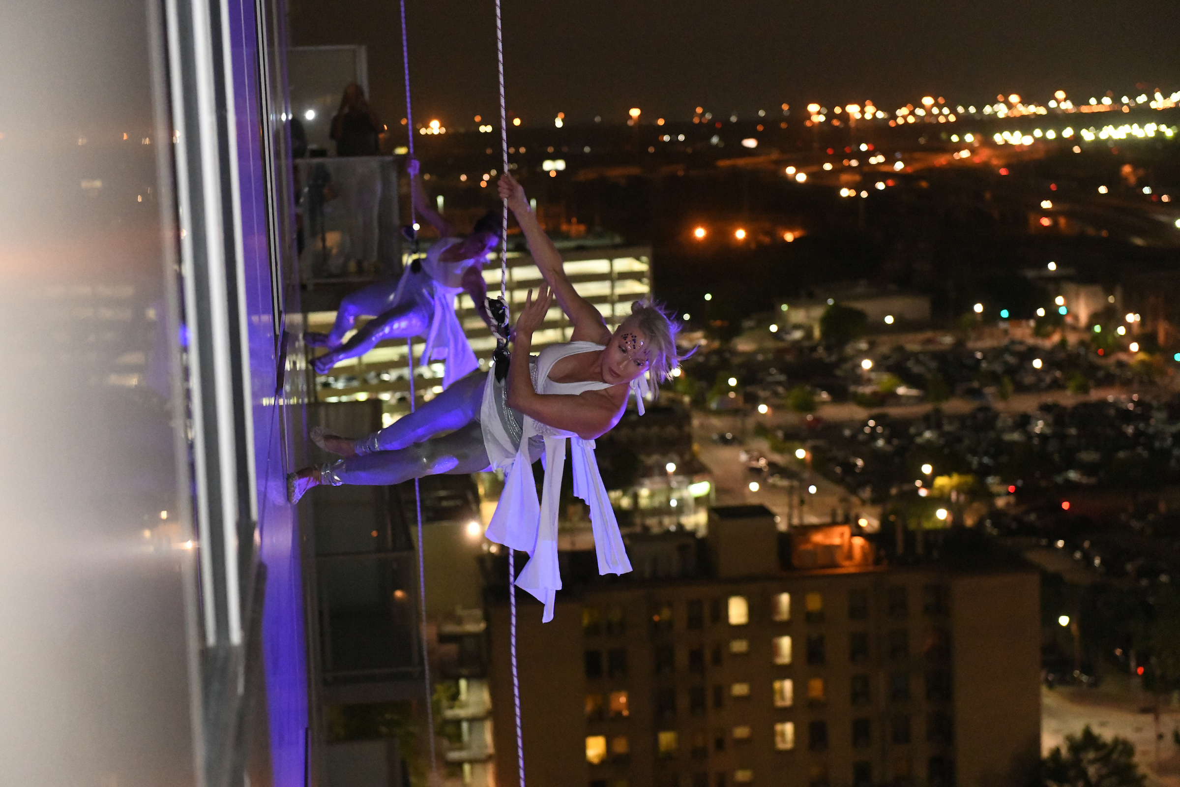 Aerialists dropped 28 stories from the top of the building.