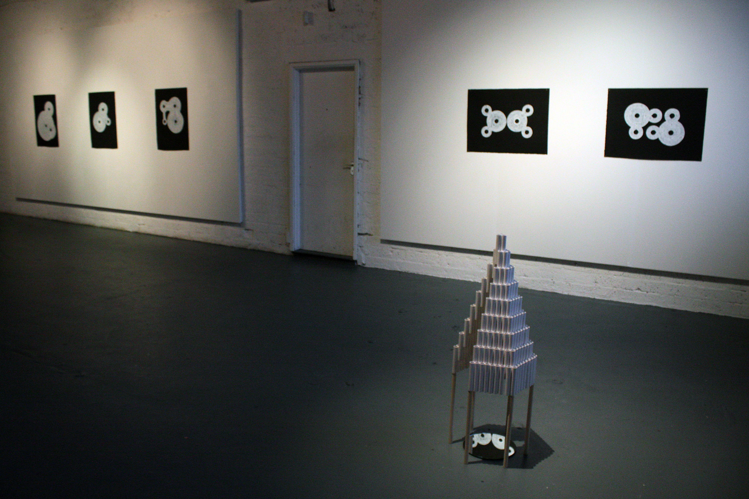 Installation view showing untitled sculpture and drawings
