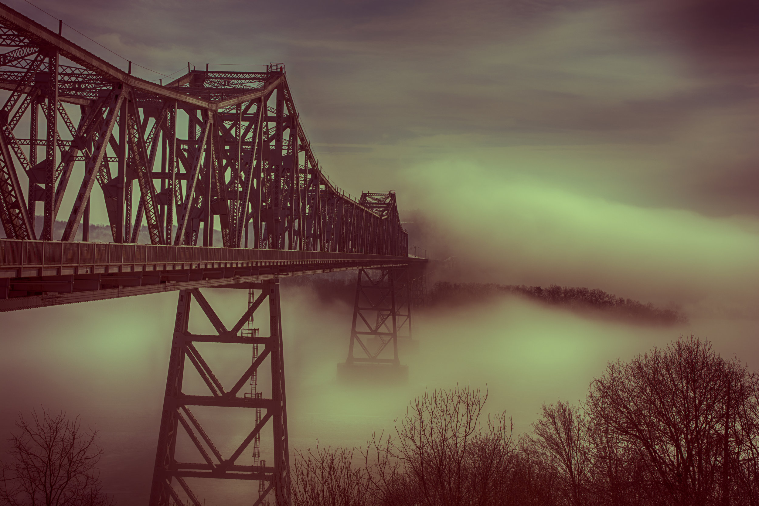 I have always been fascinated by dreams. Where do they come from? How do they develop? What meaning, if any, do they contain? Not long ago, I took a photograph of the Rip van Winkle bridge disappearing into a fog bank. It occurred to me that a dream is like that; the mind disappears in the mist and shapes and forms get distorted. A dream is a mirror image of reality on some level. My dreams are populated with people I know and on rare occasions, by creatures from the darkest depths of my id. Sometimes I remember them in great detail. More often only an uneasy feeling remains. I don't know how to interpret my dreams and I'm not sure I really want to learn. There are instances when I can connect a dream to some final thought as I drifted off to sleep. But it is the element of surprise that is more intriguing to me! Where did that come from? As disconcerting as they can sometimes be, I know one thing for sure; if I'm still dreaming I'm still alive, and that's a good thing! Here is my Bridge in Fog in 4 parts:
