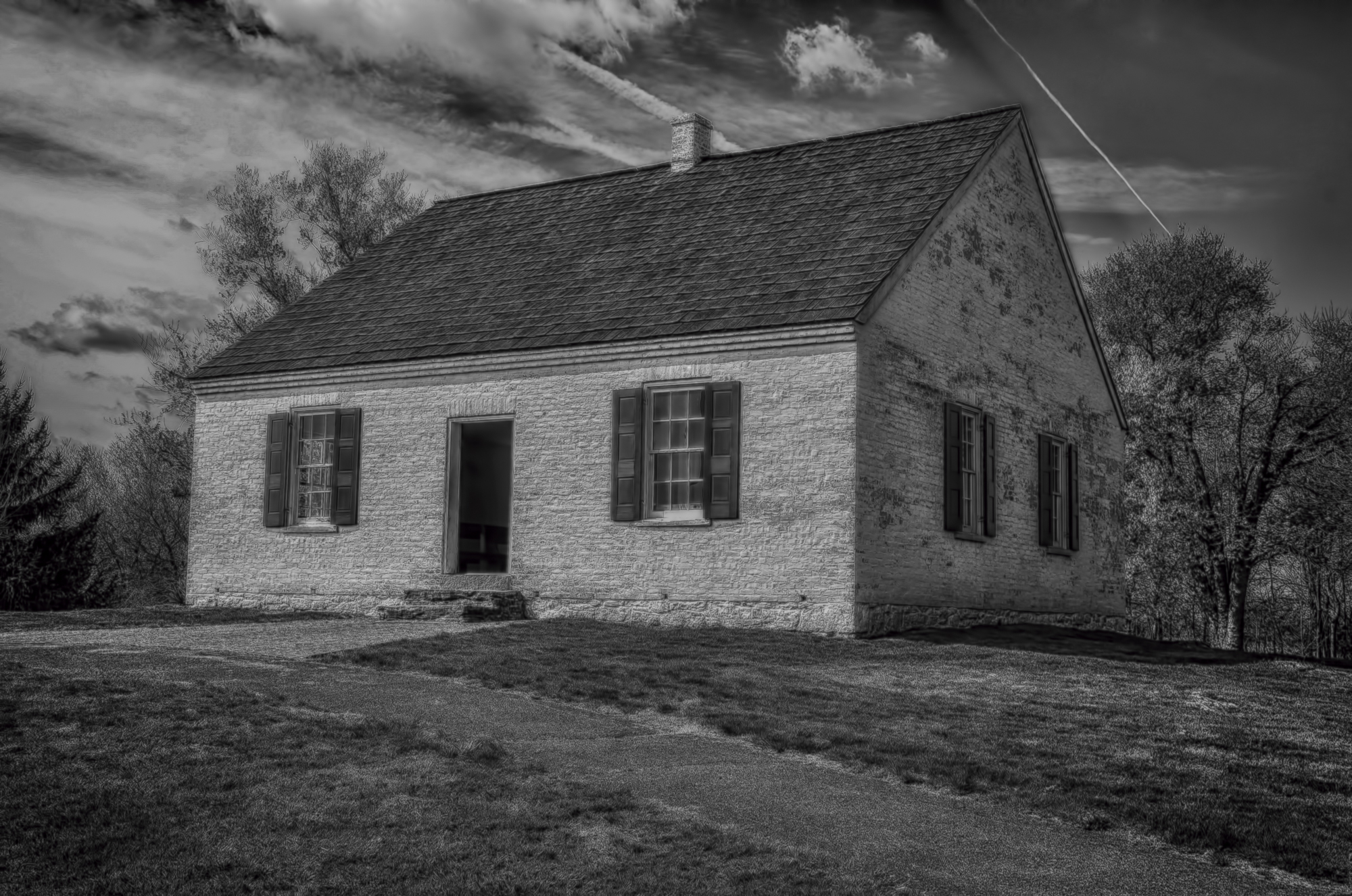 Dunker Church - Antietam National Battlefield - I have had a fascination with the American Civil War since I was a young boy. I have been to Gettysburg more times than I can remember. My bookshelves at home are stacked with Civil War history. I have been on bus tours, attended seminars and created and taught a high school course on the war. The poem you are about to read pertains to my second favorite battlefield site; Antietam. I am proud to say that I have donated money to the Civil War Preservation Trust (of which I am a member) to help save a portion of this sacred ground from development. My oldest son began his professional career here as a member of the National Park Service. So, like Gettysburg, I have walked this battlefield on many occasions. I believe that Antietam, not Gettysburg, was the turning point of the Civil War. Above all tactical and strategic considerations, the battle changed the meaning of the war. After all, Antietam gave us the Emancipation Proclamation. The battle unfolded in three distinct phases; morning, mid-day and afternoon. Each phase centered around a landmark you can still visit today. The Dunker Church (above) for the morning phase, a sunken lane for the mid-day phase, and finally closing around a bridge that became known to history as Burnside's Bridge. Lincoln did visit the battlefield shortly after its conclusion. The poem Antietam Creek follows the course of the battle including Lincoln's visit.