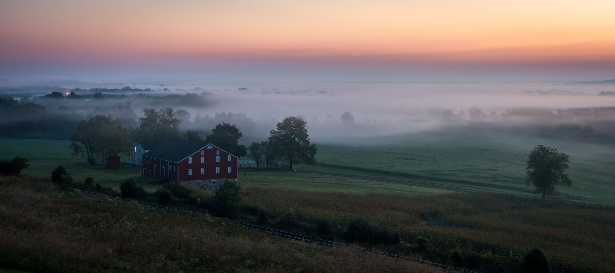"""Gettysburg Dawn - Nikon D7100 - September sunrise from an observation tower on the first day's battlefield. Gettysburg National Military Park. This photograph appeared in a juried show. See the poem """"Waking Up"""" in the Poetry Section."""