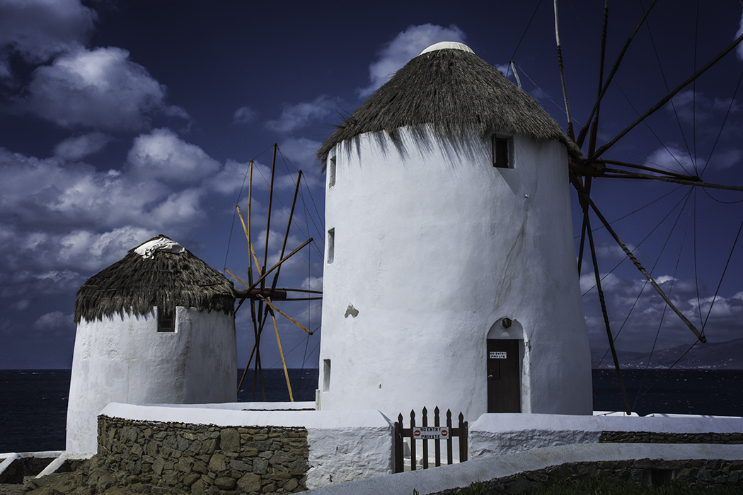 Windmills of Mykonos - Nikon D7100, 1/160 @ f/14, ISO 200, 25mm - The circular polarizer made the shot. One of my most popular photographs!