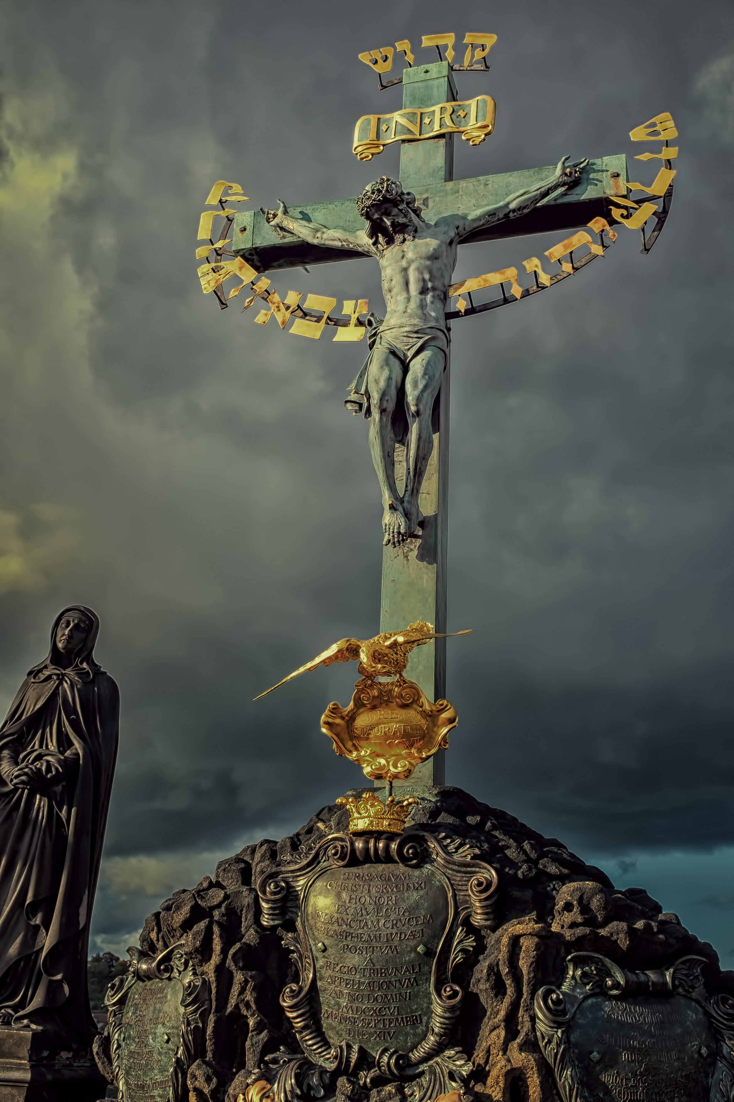 This photograph was taken on a recent tour of Central Europe. This is the Charles Bridge in Prague which is lined with religious iconography including this crucifixion scene. I lost track of the number of cathedrals and shrines we visited, but they all had one common denominator; great displays of wealth and splendor. I have always been struck by the dichotomy of extreme poverty in the shadows of great wealth. Particularly when that wealth is embodied by the Christian faith; a faith based on humility and the grace of the dispossessed. Go inside any of these cathedrals or walk across the Charles Bridge and you will find the faithful, but also the curious, the lost, the poor. Walk a few blocks in any direction and you will see more of the same. I cannot help but think that some of this wealth could better serve the poor I saw on Charles Bridge.