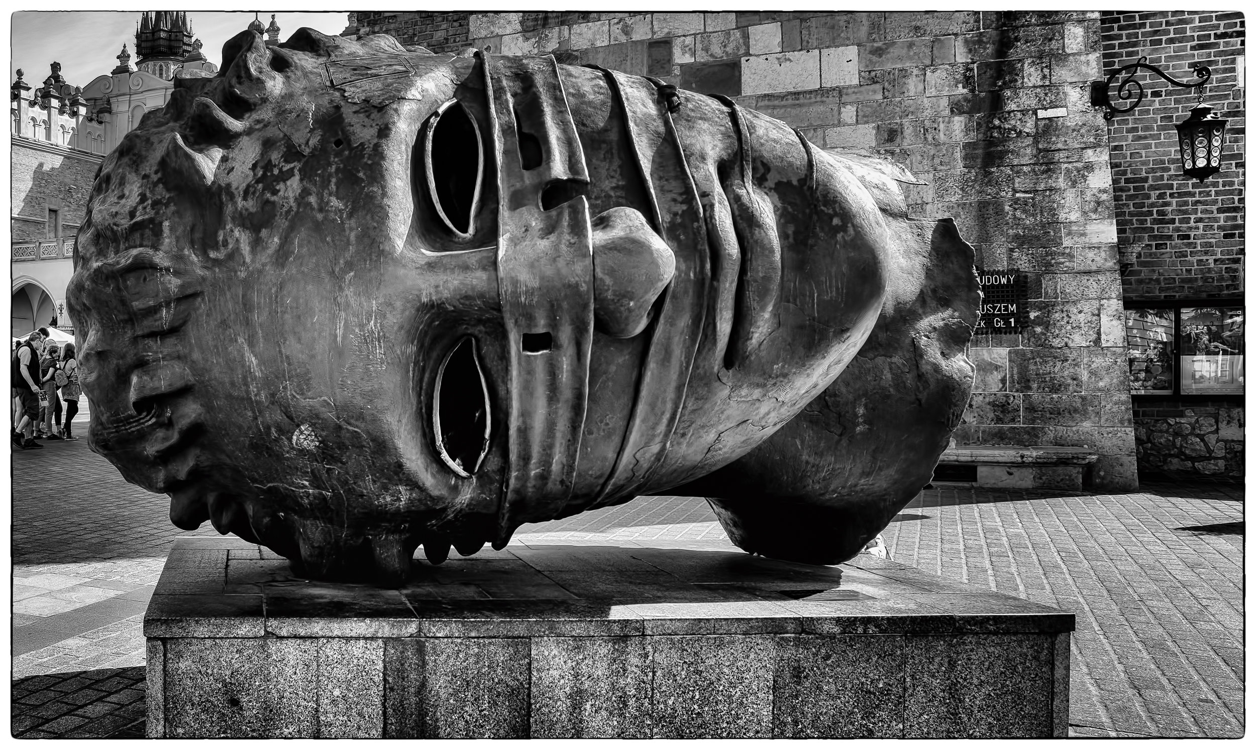 """Eros Bound - Fujifilm X 100T, 1/125 @ f/8.0, ISO200, 23mm. Photographed on a recent tour of central Europe. This sculpture can be found in the town square in Krakow, Poland. See the poem """"The Words Were There"""" in the Poetry Section."""