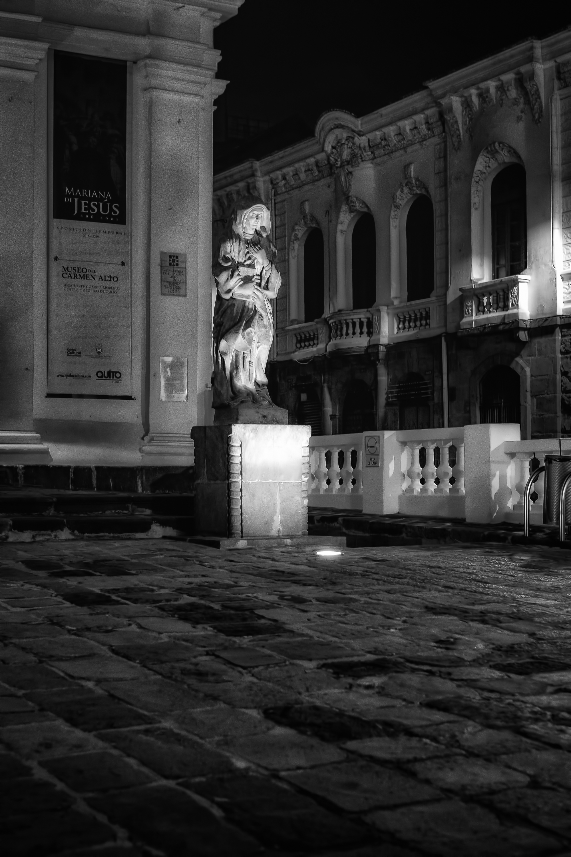 """Alone in the Square - Fujifilm XT-3, 1/60 @ f/2.8, ISO 800, Spot, 35mm. Took this shot while walking the streets of Old Town Quito at night. See the poem """"Ecuador"""" in the Poetry Section."""