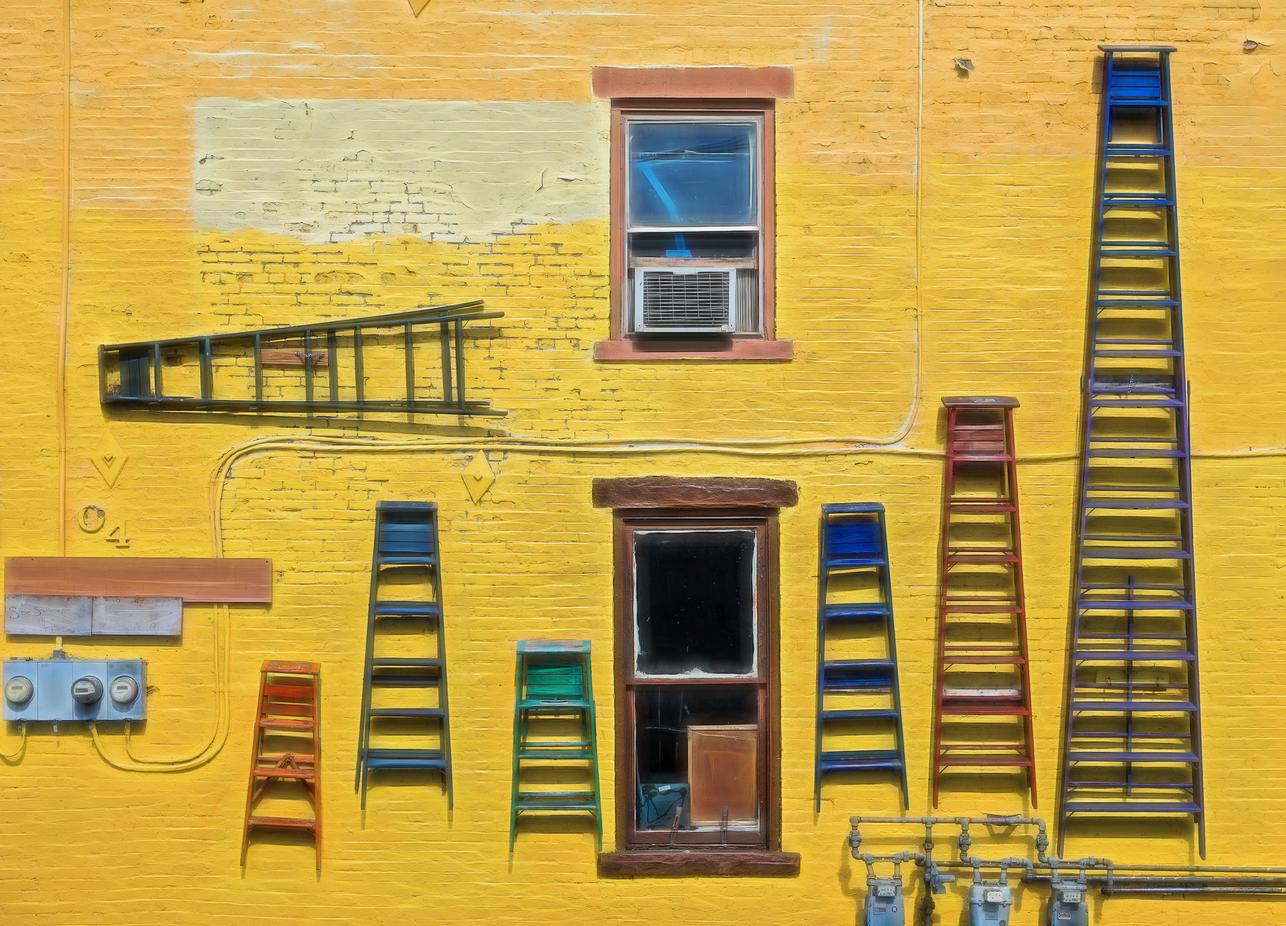 Ladders to Nowhere - Nikon D750, 1/400 @ f/9.0, ISO160, 52mm. Yes, this building does exist! It's in the city of Hudson in New York State. Call it urban art writ large. I love it! Anyway, it makes for a fun photograph.