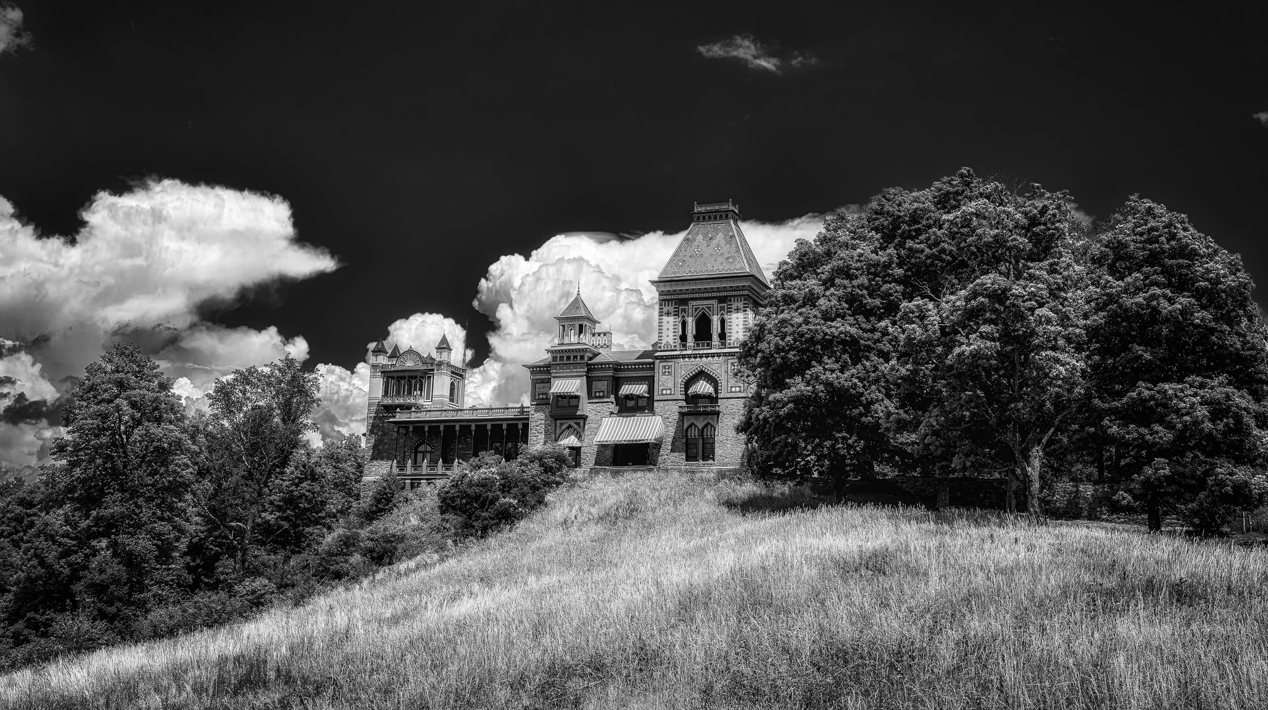 Summer at Olana - Nikon D750, 1/200 @ f/13, ISO 100, 42mm. The home of Frederic Church, one of the foremost painters of the Hudson River School. I have shot here many times but this is the first black and white that works for me. Nice puffy clouds and an unobstructed view from a lower elevation, adds to the majesty of the home. I added a red filter in post to increase the contrast between the clouds and the sky.