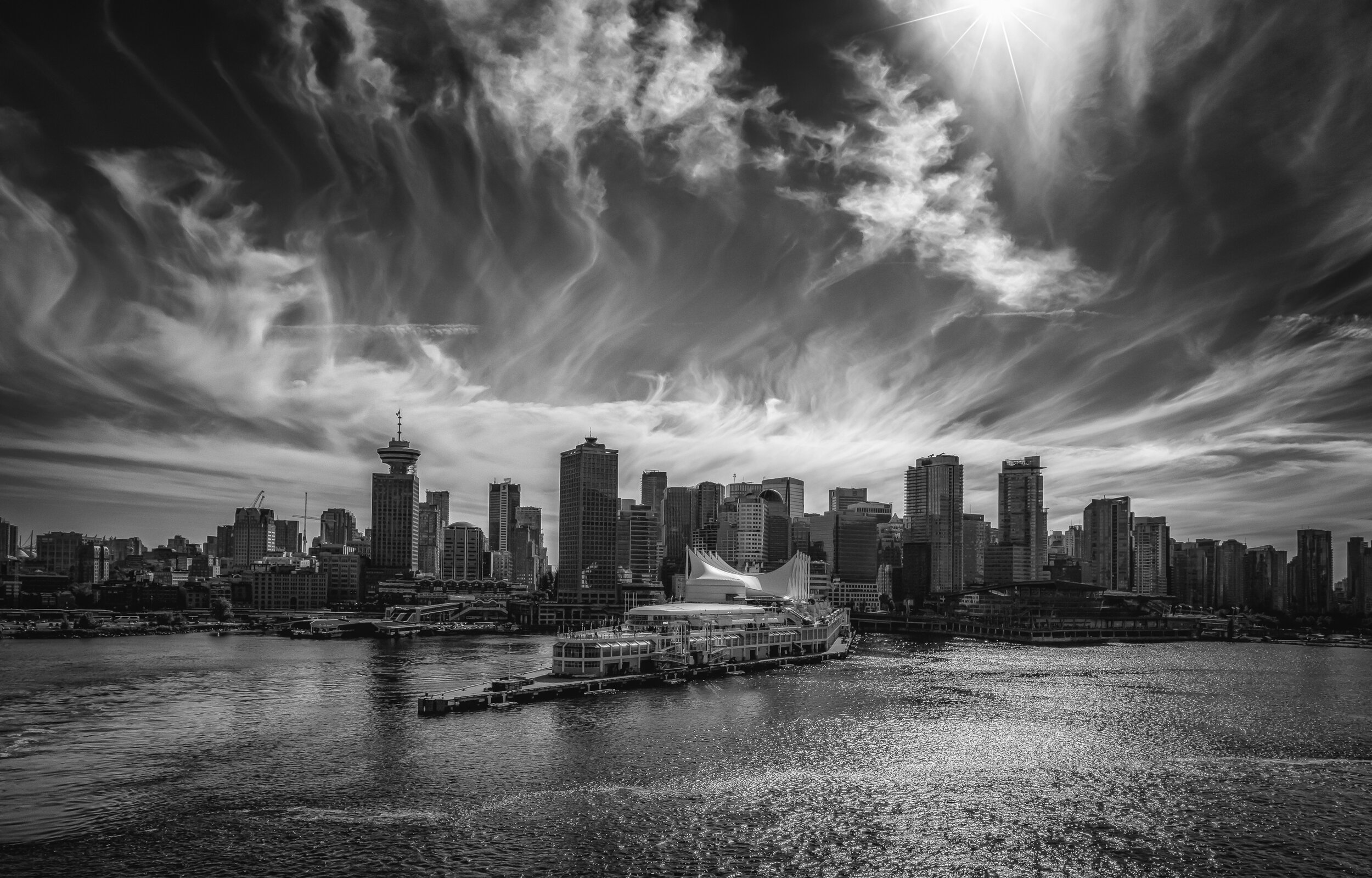 Vancouver - Fujifilm XT-3, 1/500 @ f/11, ISO 160, 16mm. This a shot of the Vancouver skyline as our cruise ship pulled away from the port facility in the center foreground. I used a wide-angle lens with a polarizer and I was rewarded with a fabulous sky! I added the star effect in post.