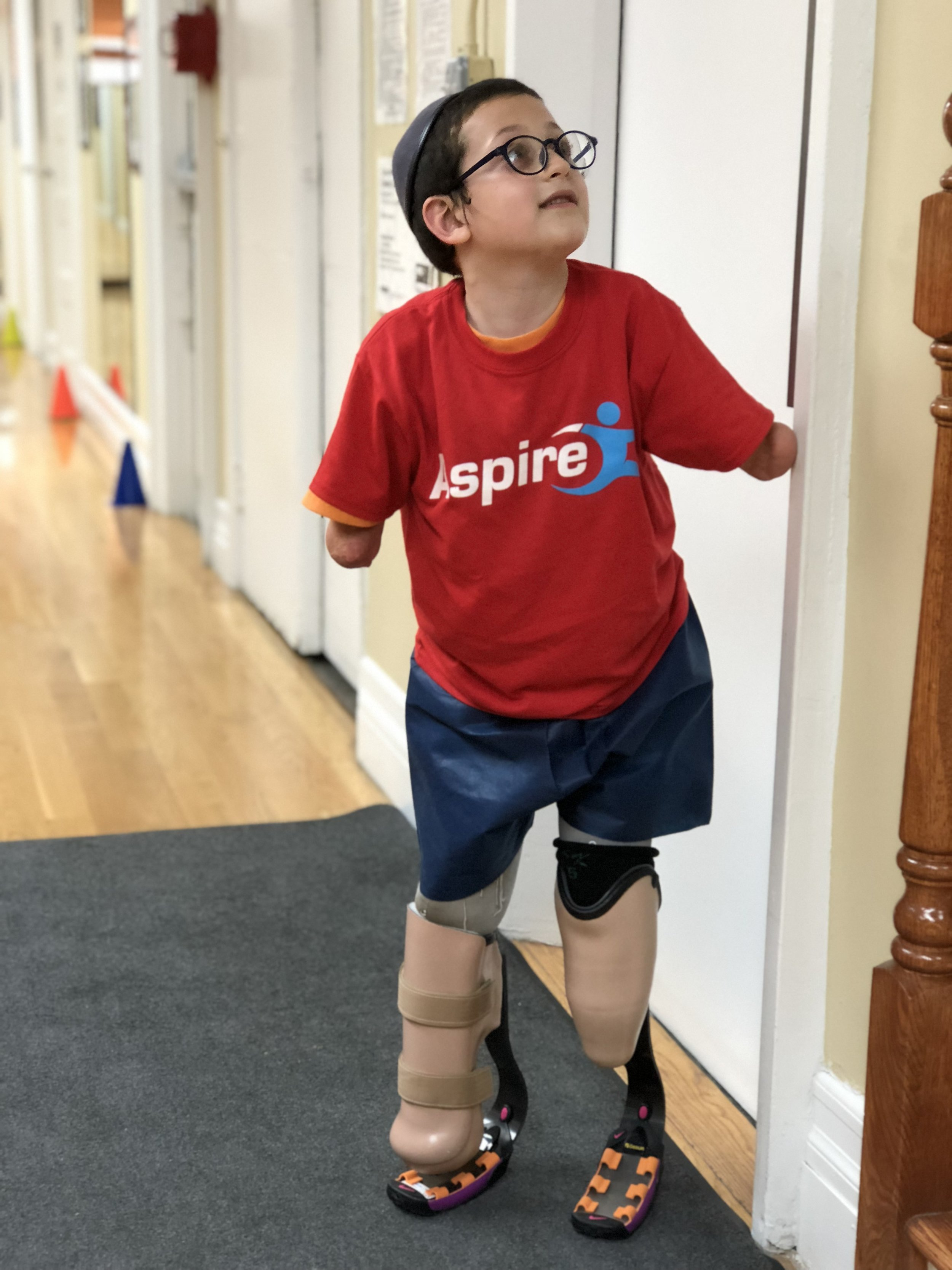Moshe - As a result of meningitis at 6 months Moshe became a quadrilateral amputee. ASPIRE has provided Moshe with running prosthesis so he is able to run around with his friends at camp.