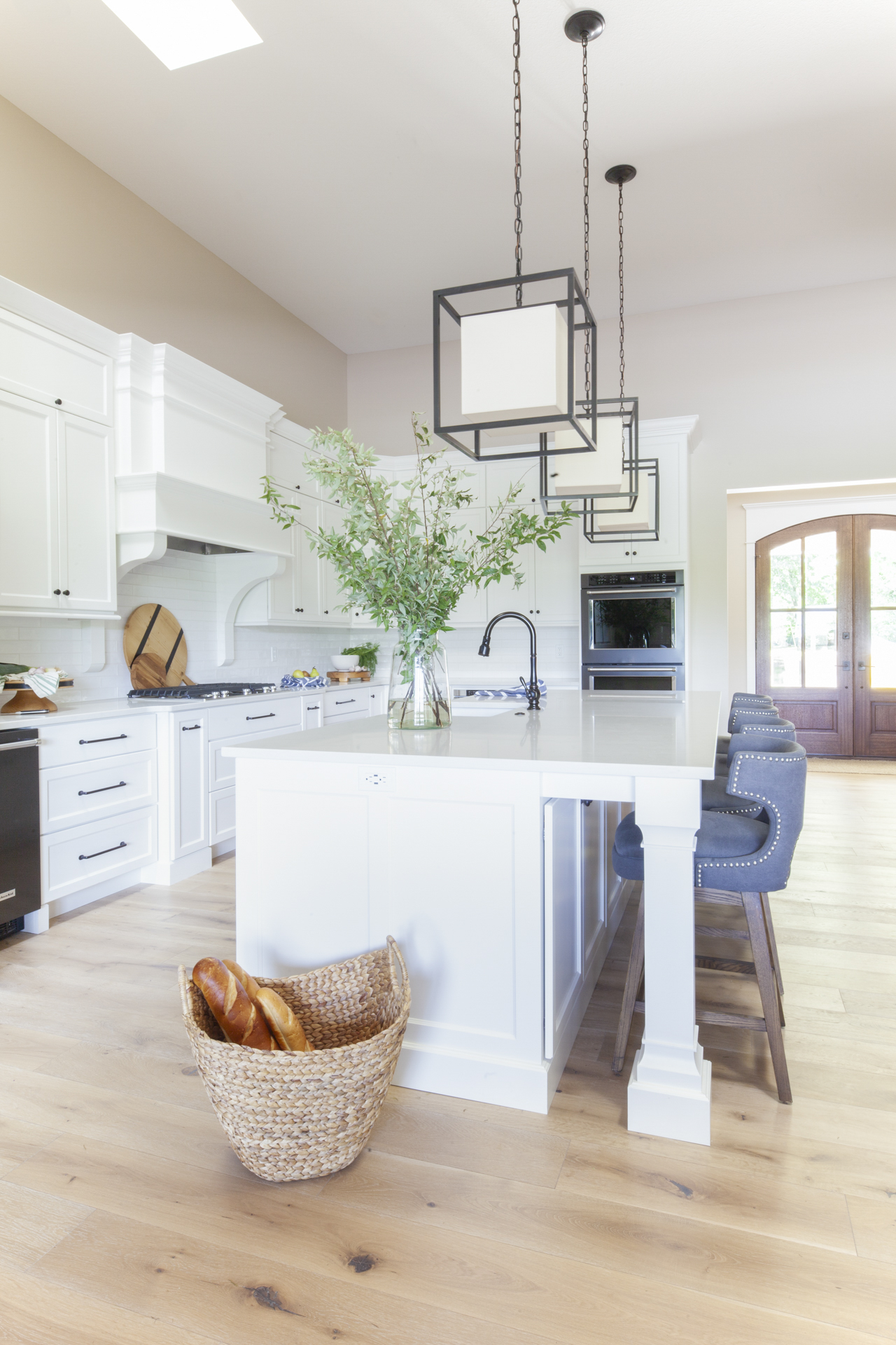 before-and-after-home-reveal-scout-and-nimble-lake-view-luxe-country-interior-design-kitchen-luxury-light-modern-subway-tile-pendant-lighting-kitchen-white-cabinets-40.jpg