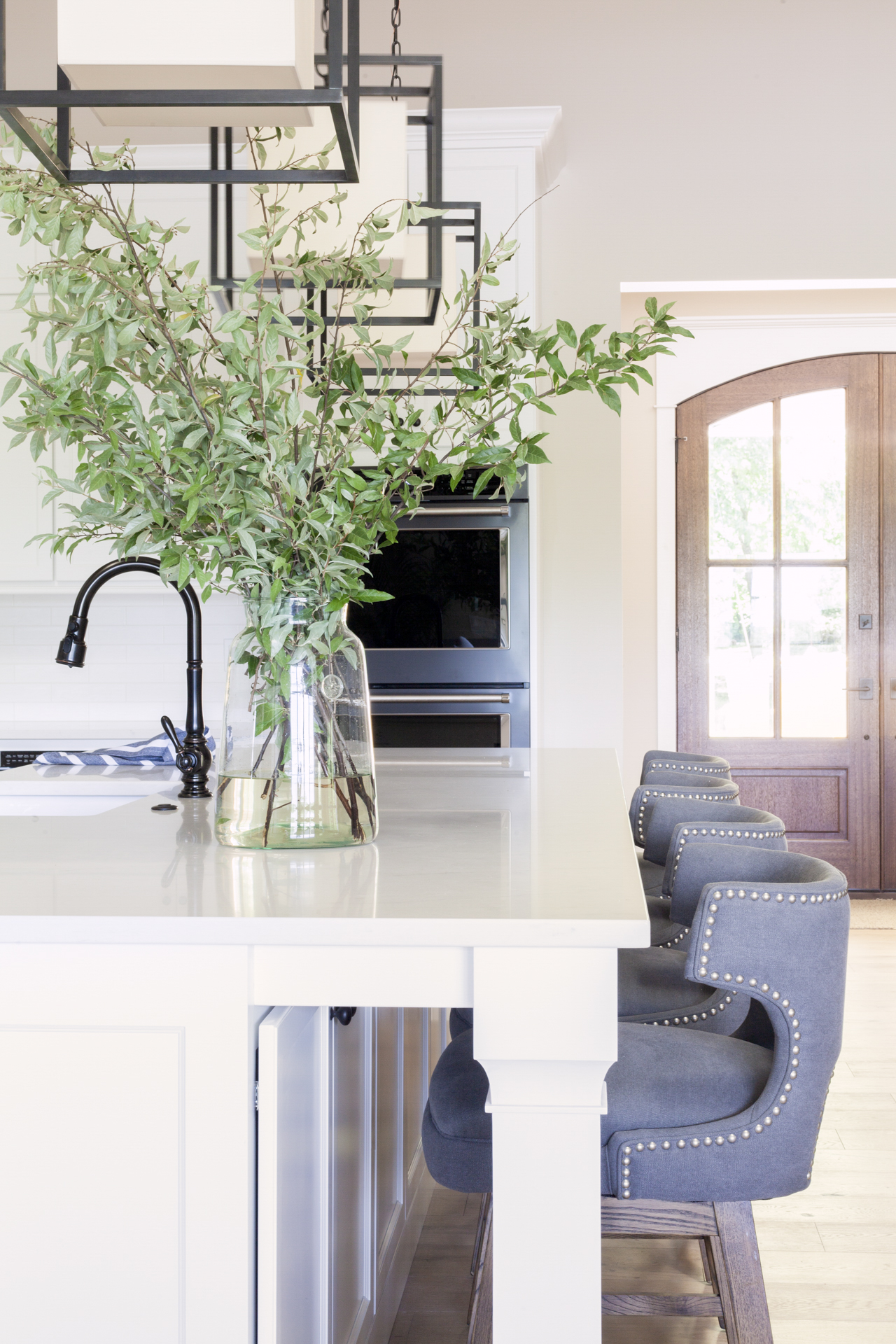 before-and-after-home-reveal-scout-and-nimble-lake-view-luxe-country-interior-design-kitchen-luxury-light-modern-pendant-white-kitchen-modern-vase-counter-stools-41.jpg