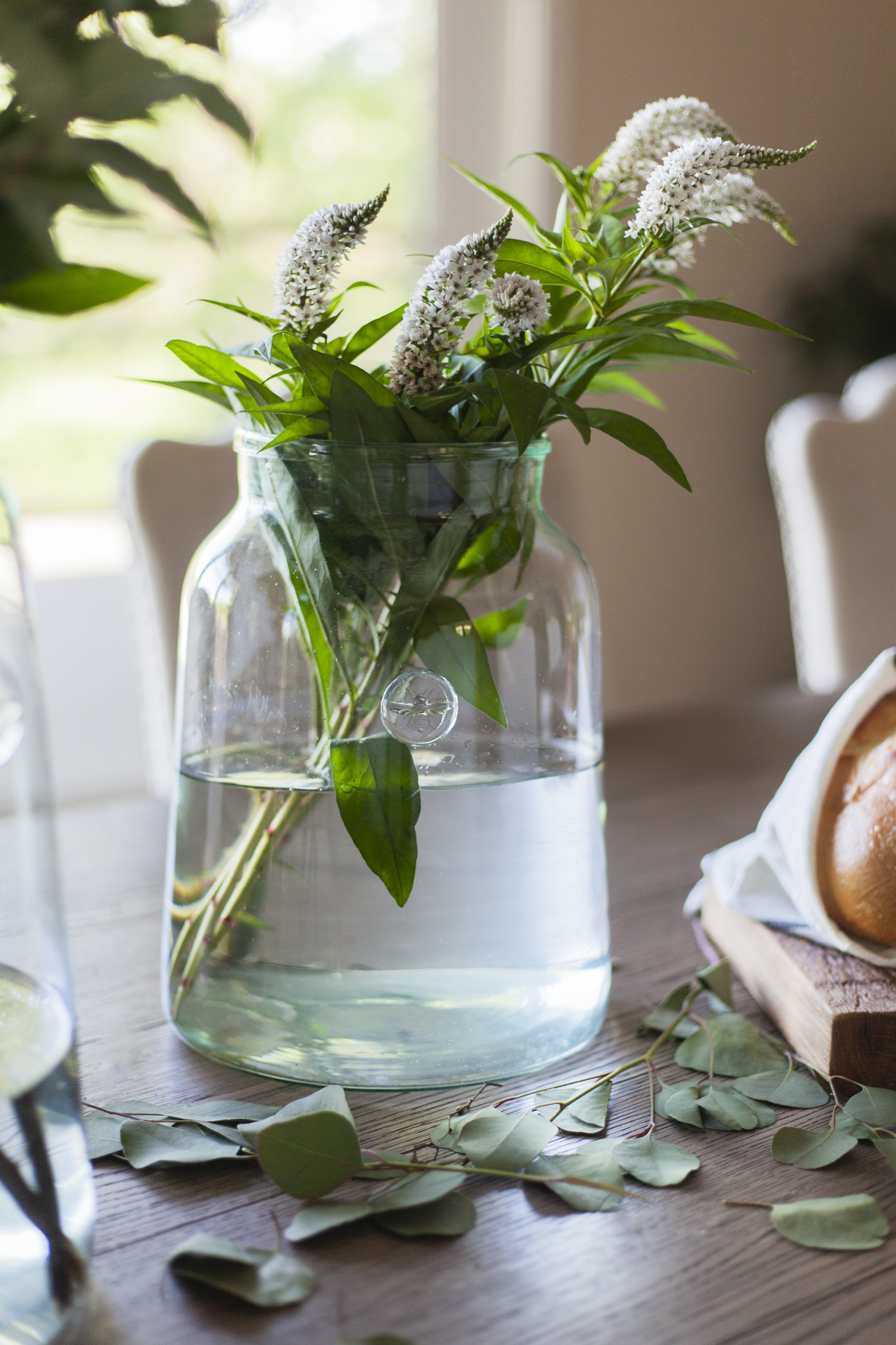 before-and-after-home-reveal-scout-and-nimble-lake-view-luxe-country-interior-design-dining-room-vase-wild-flowers-63.jpg