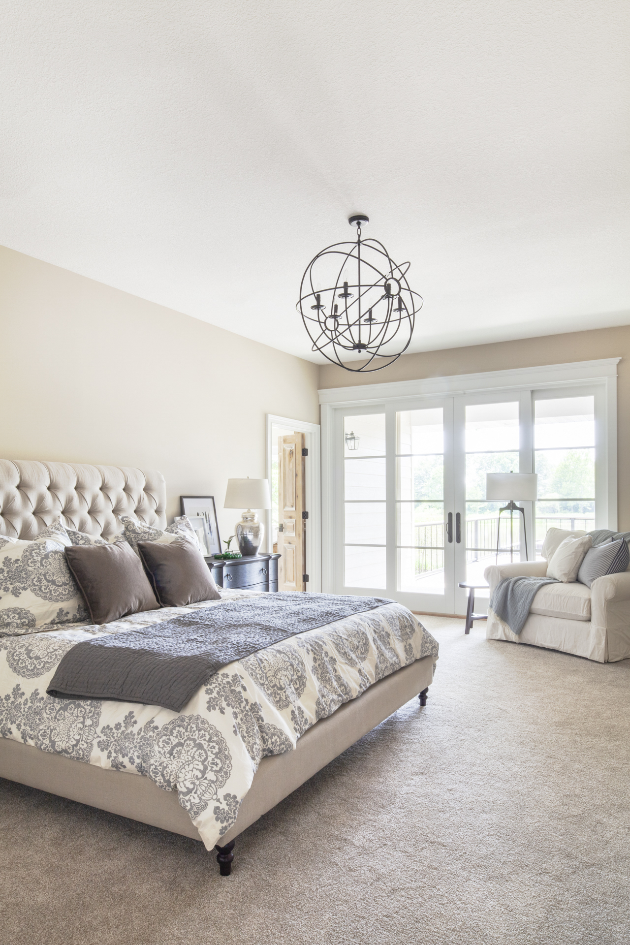 before-and-after-home-reveal-scout-and-nimble-lake-view-luxe-country-interior-design-bedroom-iorn-chandelier-tufted-headboard-102.jpg