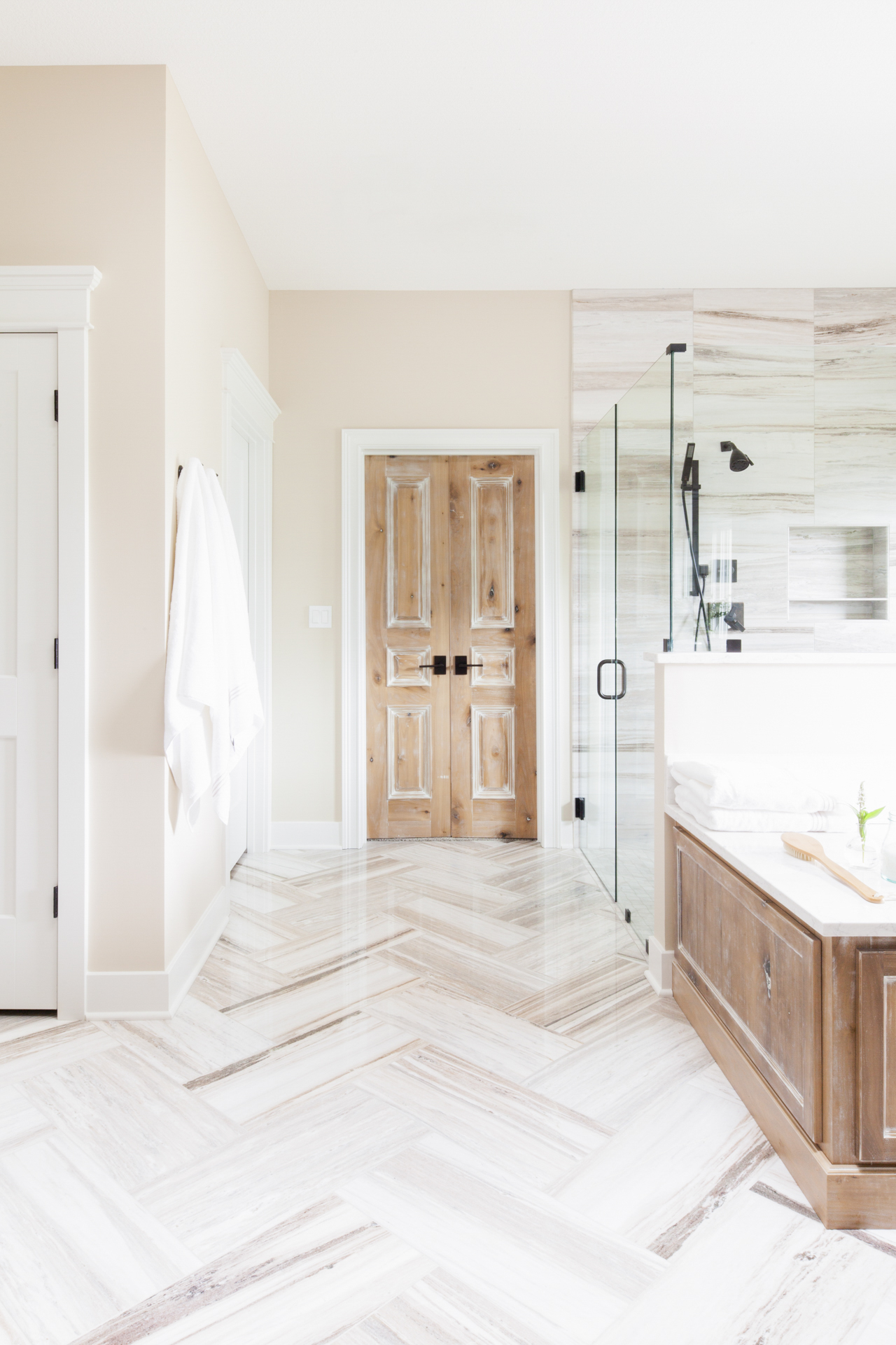 before-and-after-home-reveal-scout-and-nimble-lake-view-luxe-country-interior-design-luxury-bathroom-poplar-wood-doors-palo-sandro-marble-floor-herringbone-zero-entry-shower-basketweave-tile-8.jpg