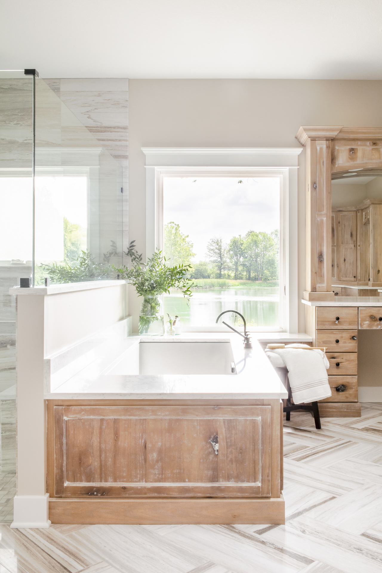 before-and-after-home-reveal-scout-and-nimble-lake-view-luxe-country-interior-design-luxury-bathroom-poplar-wood-doors-palo-sandro-marble-floor-herringbone-zero-entry-shower-basketweave-tile-9.jpg