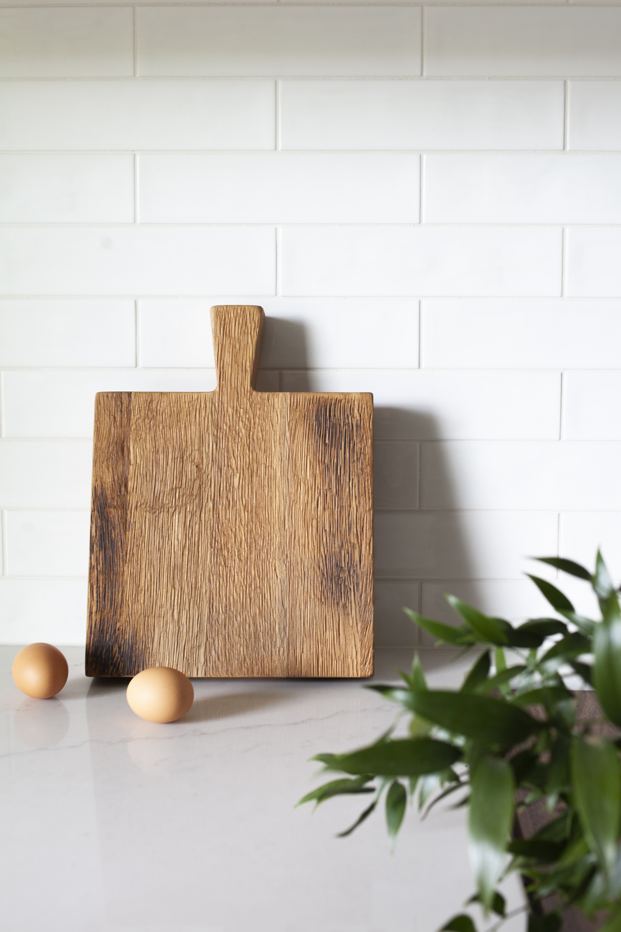 French Cutting Board, $112   Quality, reclaimed, refined : the makings of a cutting board that will stand the test of time. The French Cutting board is square, sporting its  natural texture  and hand finished with organic oil. It's  a kitchen go-to  and a cheese and appetizer platter to boot. The sturdy handle and utility will transport your gift-receiver right into a European countryside oasis. The differing textures add to the charm: one side is smooth for chopping, the other is natural in texture for serving. It's as  sturdy, rustic, and classic as it is timeless.
