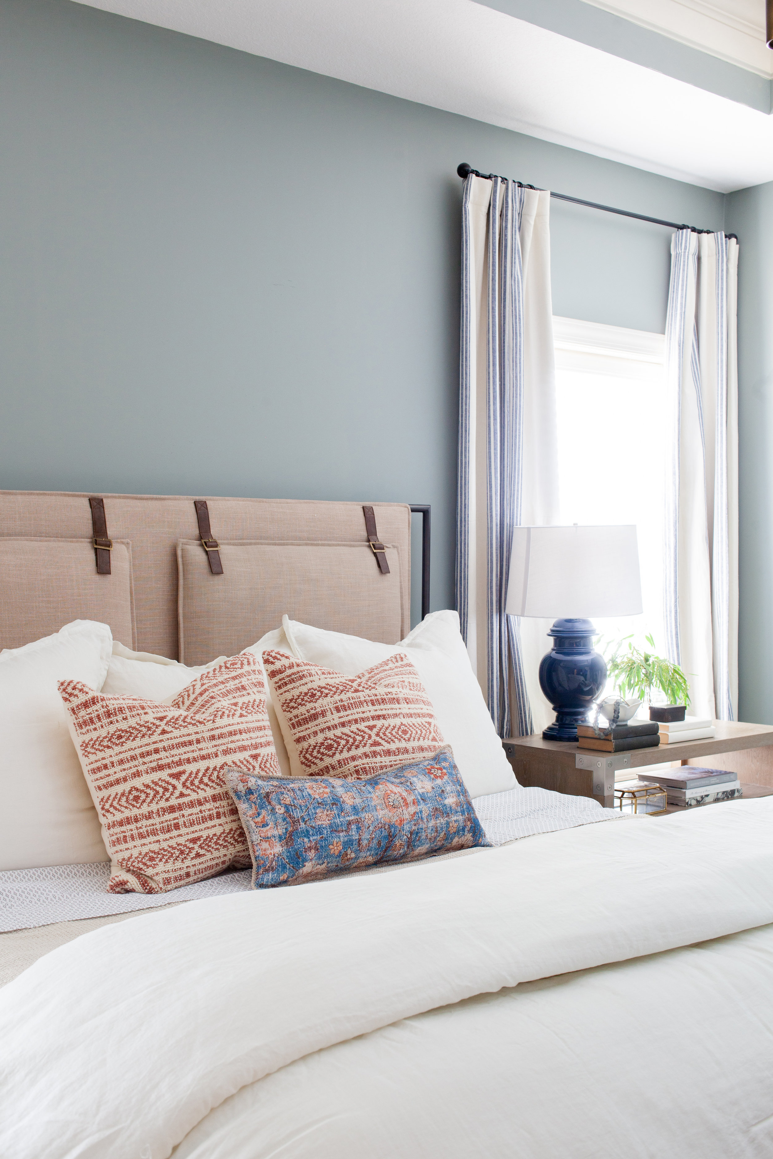SHOP THE LOOK   |   Blue/Multi Lumbar Pillow    ($69.00 - $89.00) ,    Leigh Upholstered Bed    ($1,747.08),    Keely Rust/Natural Pillow    ($89.90),    Shilo Nightstand    ($1,368.00)