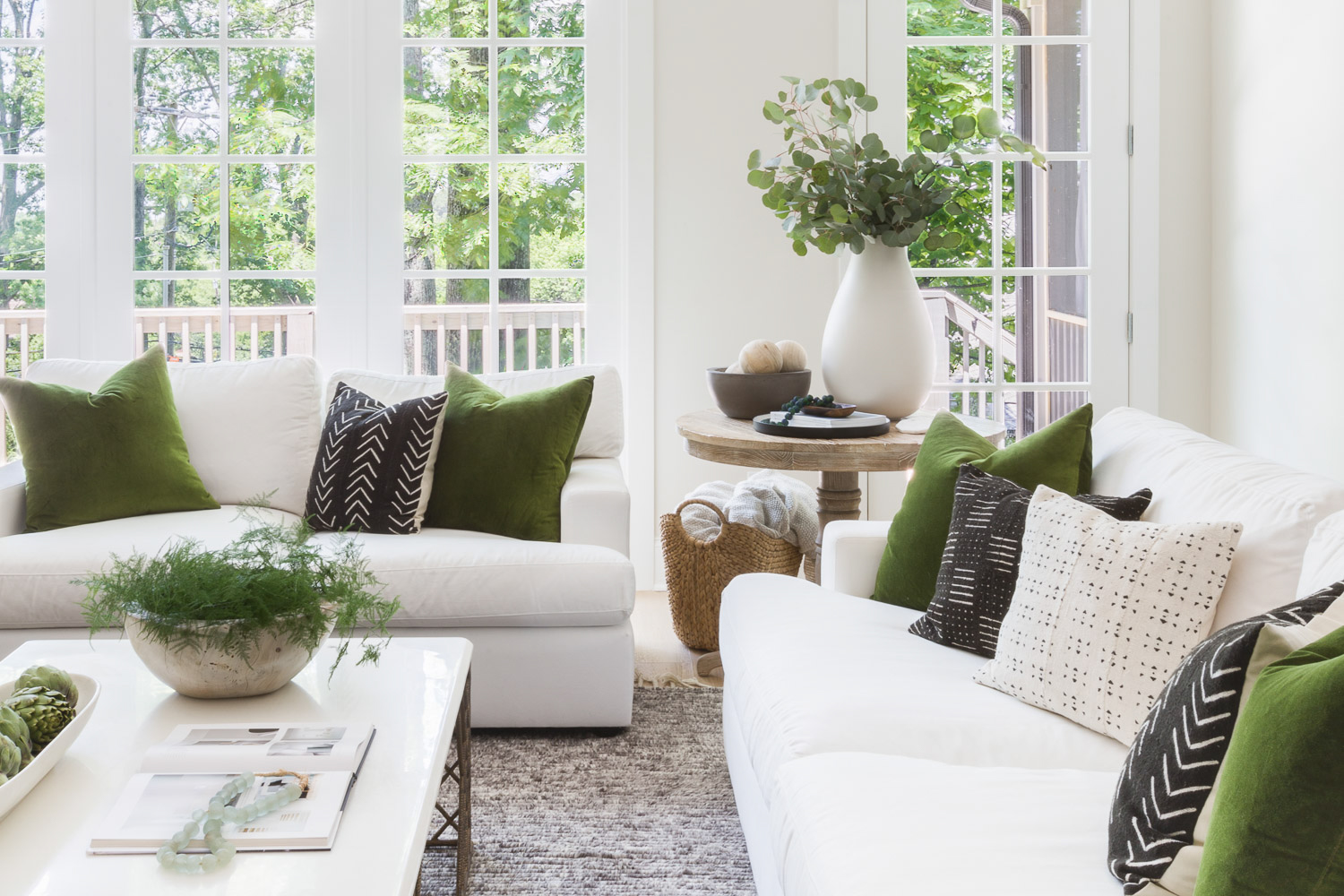 SHOP THE LOOK:    Reclaimed Wood Bowl ,  Safflower Green Velvet Pillow ,  Cassidy Coffee Table,   Aqua Glass Styling Beads ,  Round Occasional Table ,  Sydney Sofa  | Scout & Nimble Design,  Hilltop Home Project  | Photography by  Alyssa Rosenheck