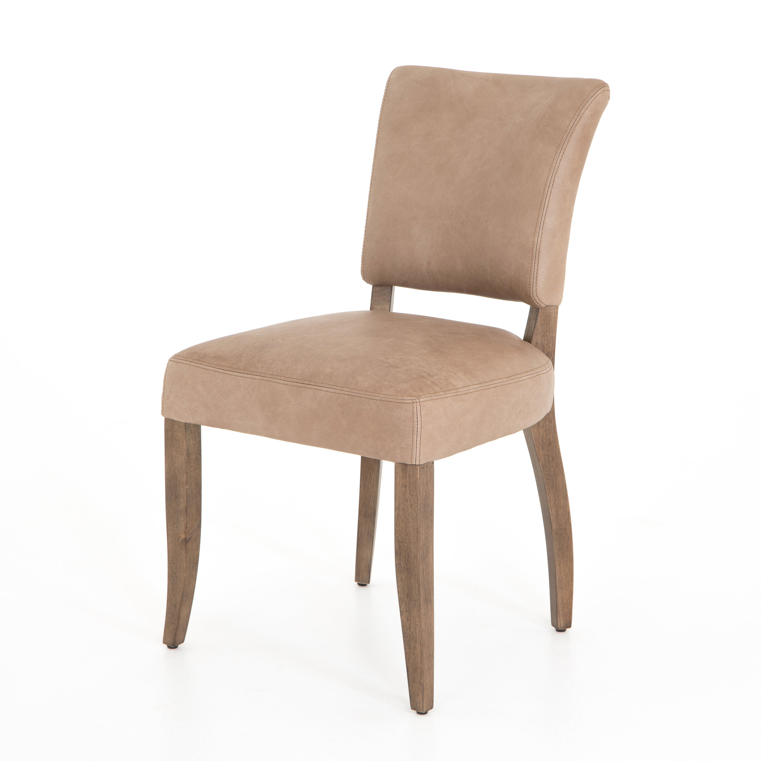 Mimi Dining Chair    |  Seductively simple. Framed by weathered oak, light tan top-grain leather features the glint of gold nail heads squaring out its back.