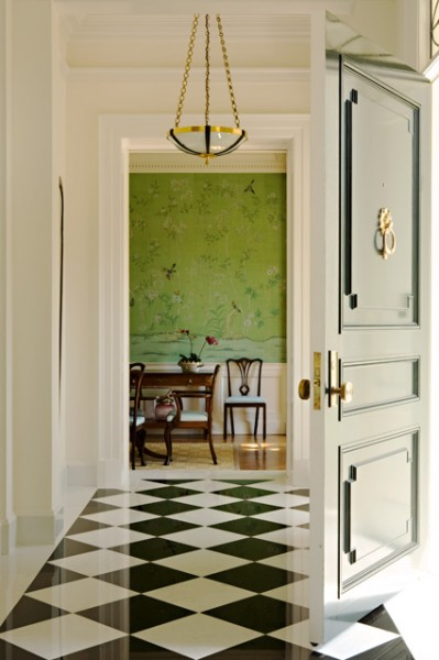 This design by  Elizabeth Dinkel  elicits the beauty that comes from stately checkered flooring. The intricate wallpaper and brushed gold accents work to add a sense of delicacy. | Photography by  Karyn Millet
