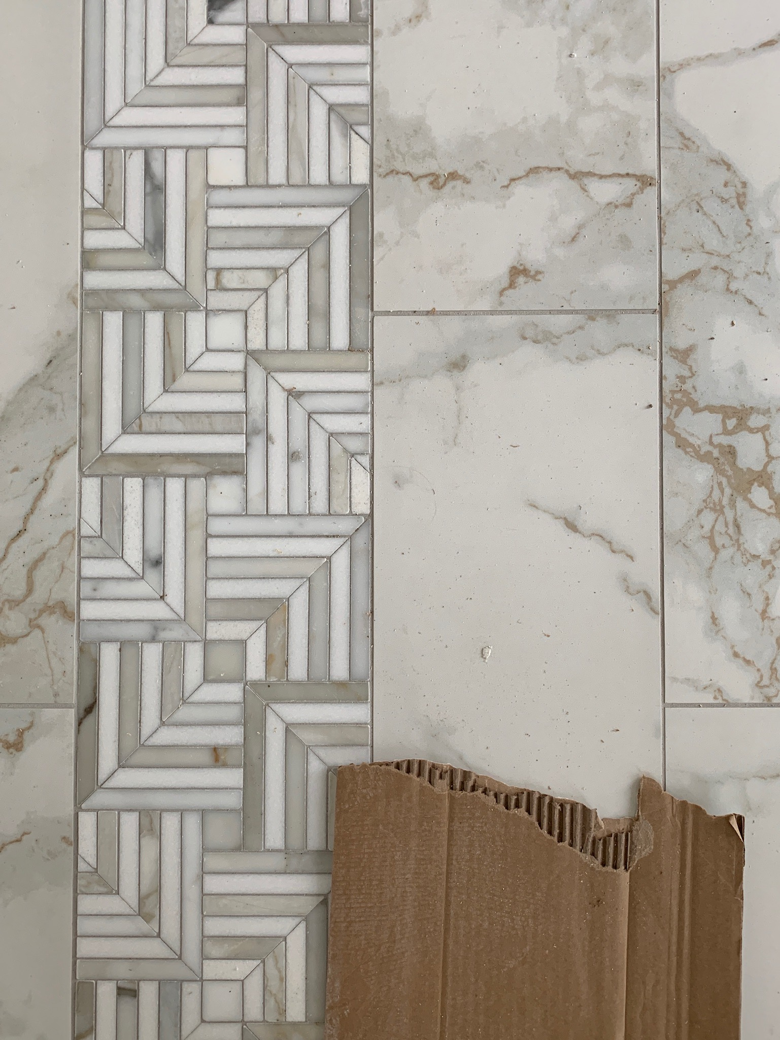 This warm-toned mosaic is marble! Such a sophisticated look for this space.