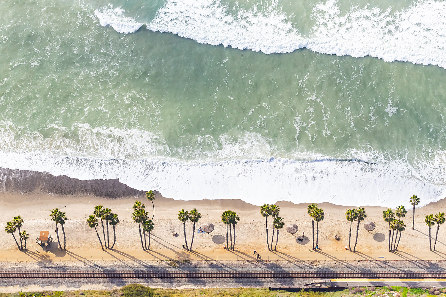 T-Street by Ryan Garvin: Above T-Street in San Clemente, this aerial shot features a popular surf spot among locals and tourists alike. The Amtrack Surfliner cruises by on the tracks multiple times a day.