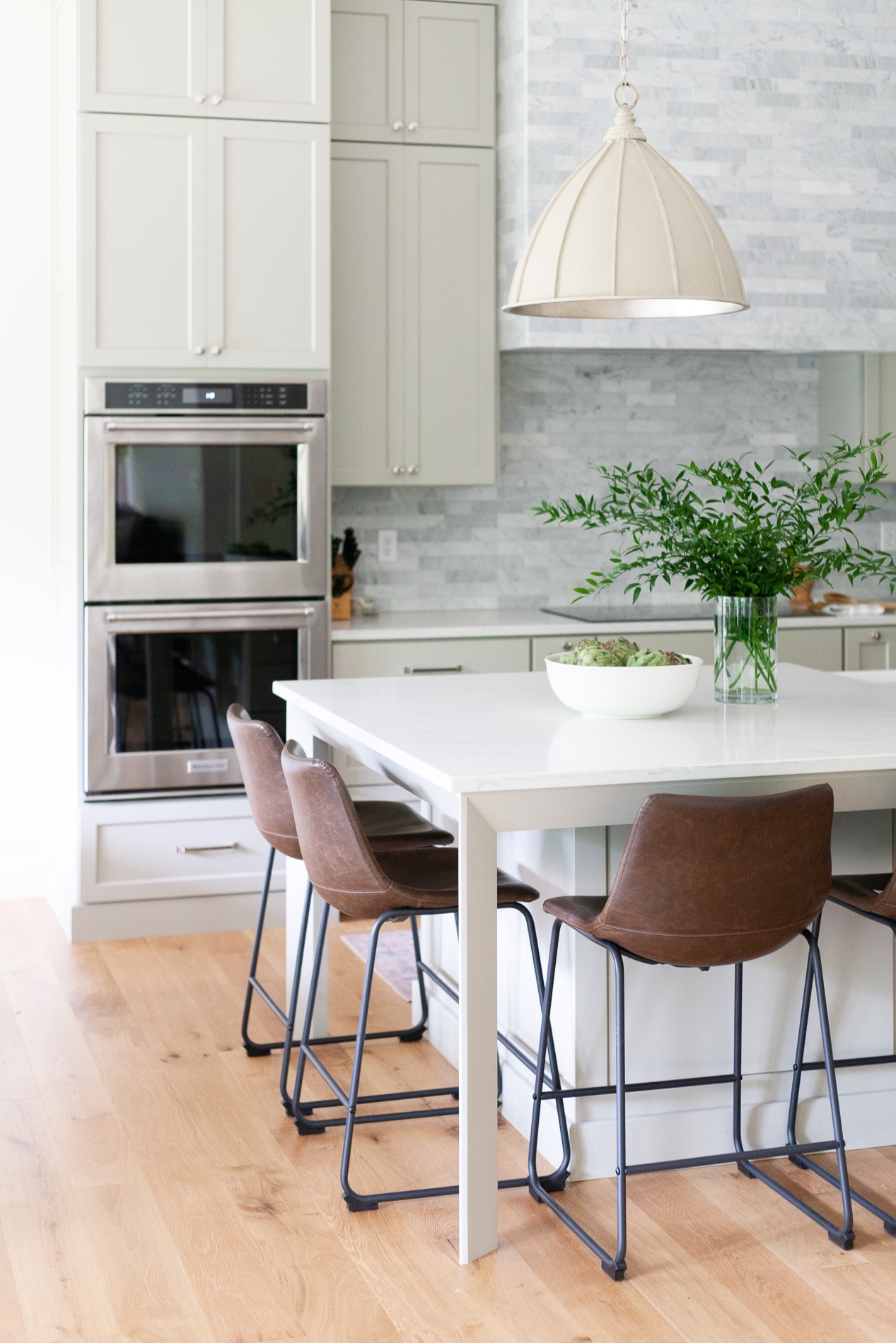We love how the  Fenchurch Pendant  looks in this dreamy, neutral kitchen.