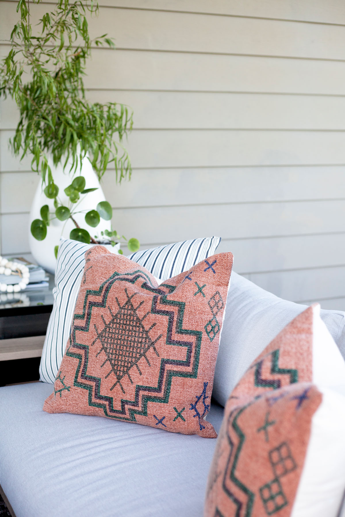These  Rust Tribal Pillows  usher in a textured, global-inspired look to any space.