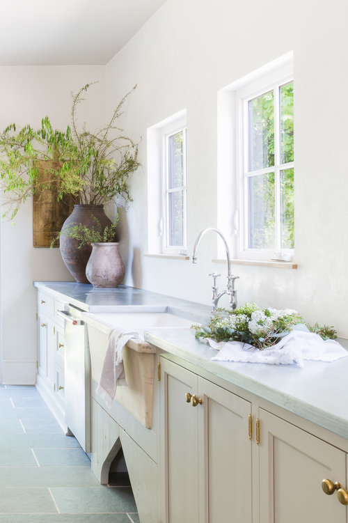 Natural light floods the space from square windows above the farmhouse sink. (Photography by  Alyssa Rosenheck )