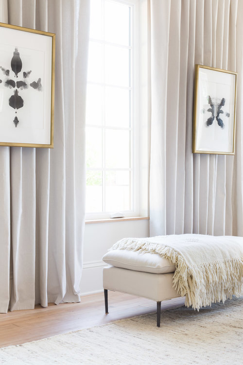 Layering white furniture pieces and accessories adds dimension and texture in a more subtle fashion. (Photography by  Alyssa Rosenheck )