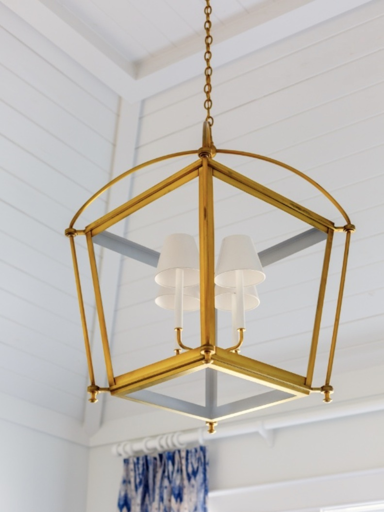 This lighting fixture combines the styles of lantern/caged lighting and a traditional lamp shade.