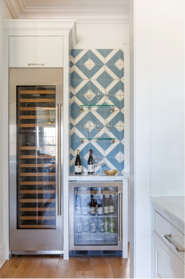 Patterned tile adds visual interest to the wine cooler and bar area.
