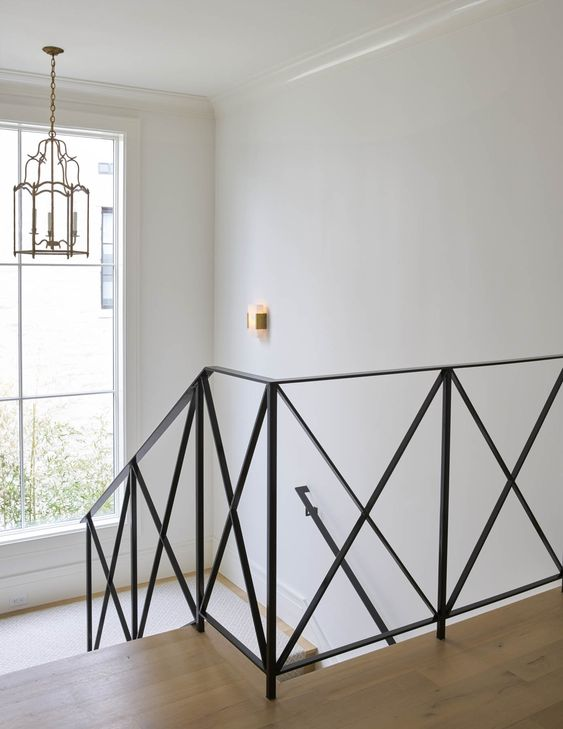 An x-frame railing in the stairway is a modern alternative to the traditional post and rail.