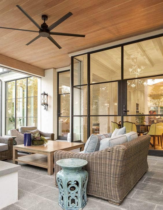Space to entertain inside and out is a must in any home, and we could personally spend all day out here! Every detail from the ceiling fan to the colored accent table pull everything together beautifully.