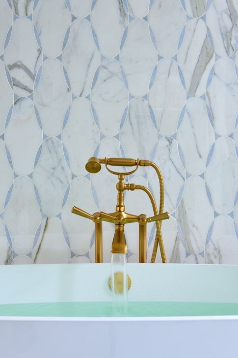 If you look closely, details like this old school tub faucet can be spotted throughout the home.