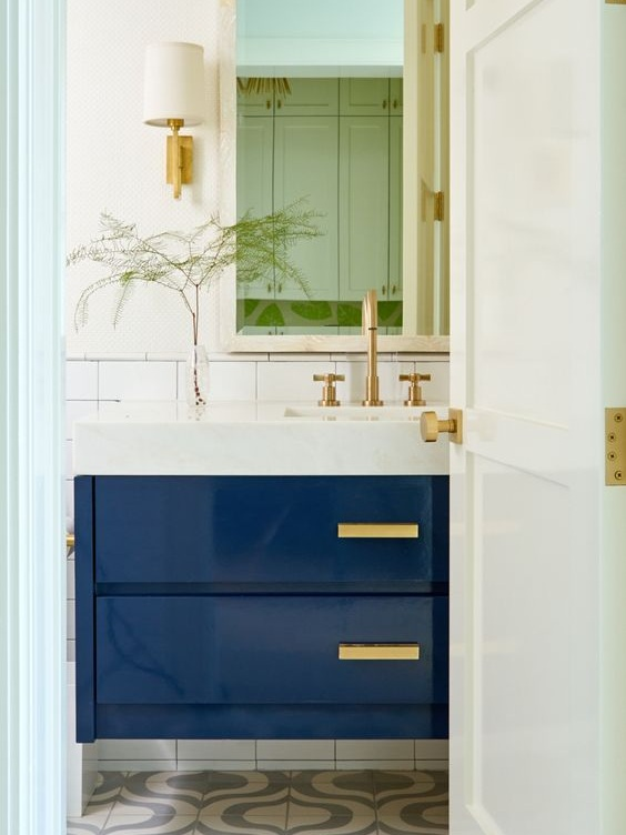 Deep blue is tied into the bathroom in this double drawer sink vanity.
