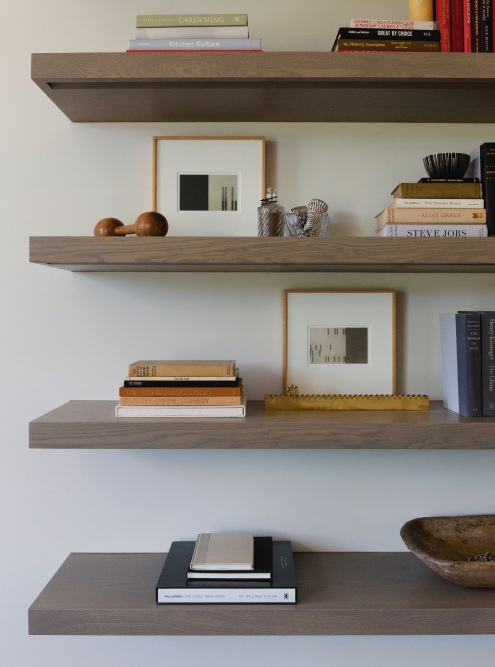 Soothing Styling | Multi-color book stacks add variety to the room's neutral palette.