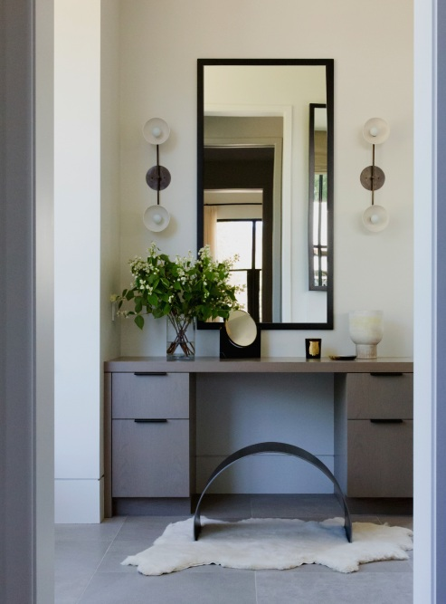 Funky Furniture | This curved vanity seat brings an unconventional flair to the master bathroom.