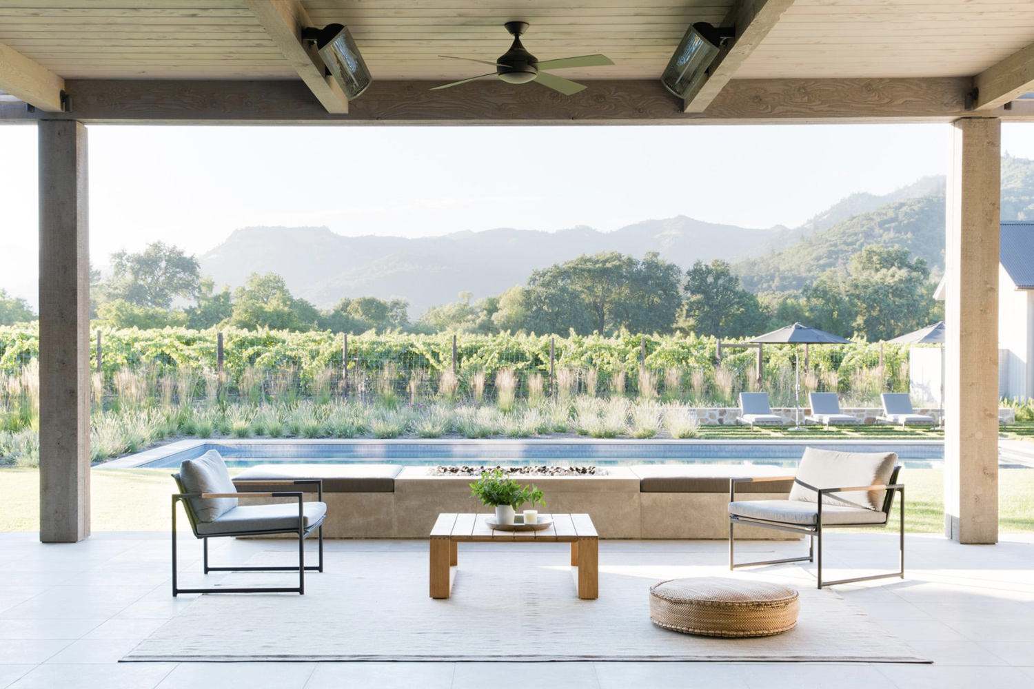 Backyard Bliss | Yet another outdoor seating area over looks the pool and vineyard.