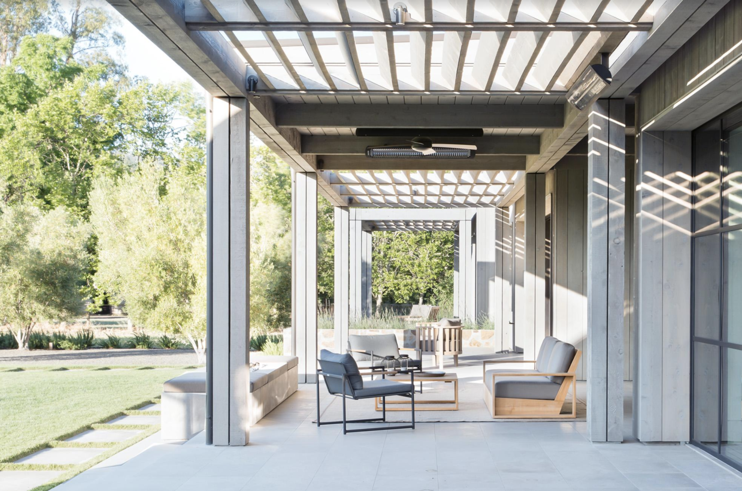 Simple and serene | A shaded patio provides a comfortable place to relax on even the sunniest days.
