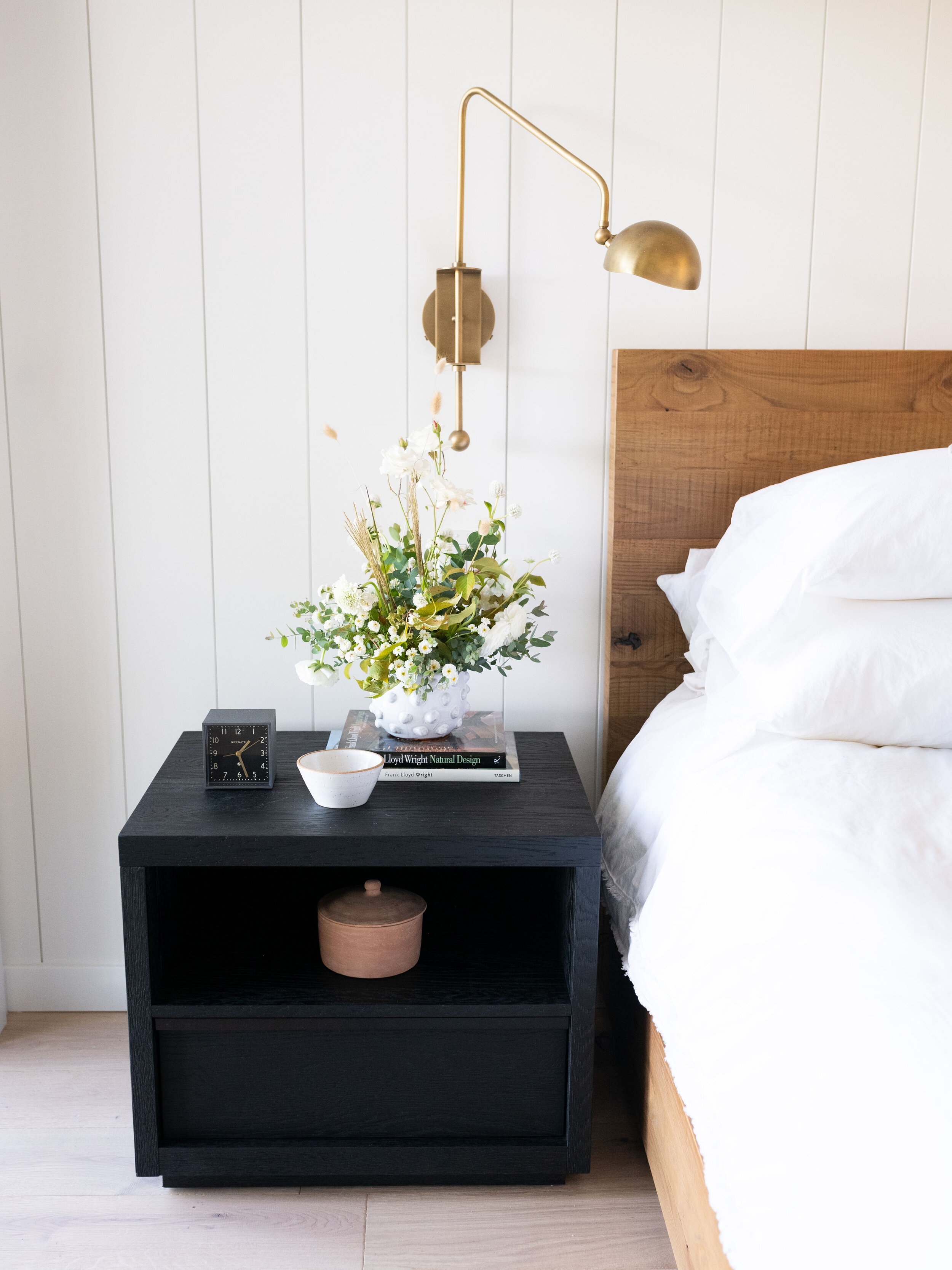 Beautiful brass accents are carried throughout the home but we particularly love this swing sconce.