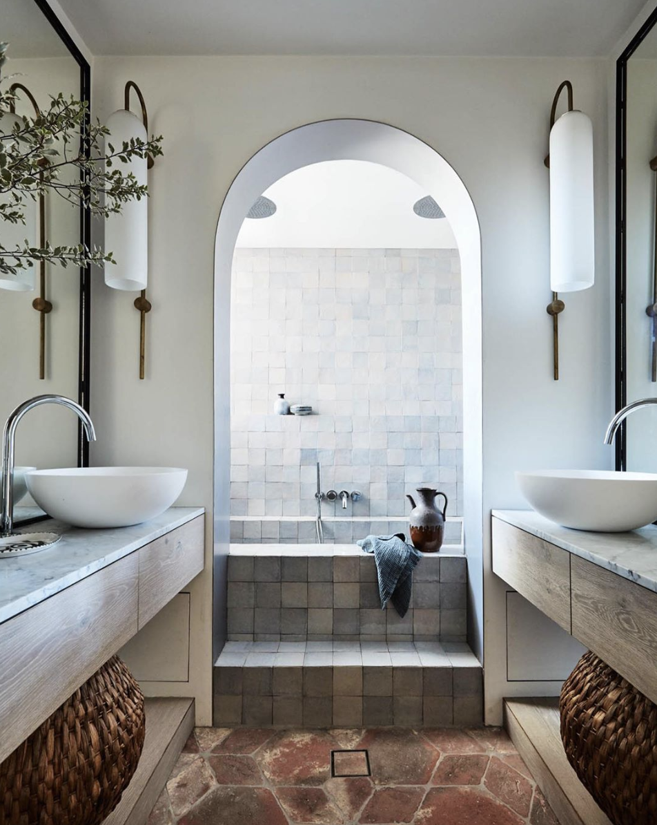 An arched entry to this show-stopping soaker tub is just one of the amazing details found in this bathroom.