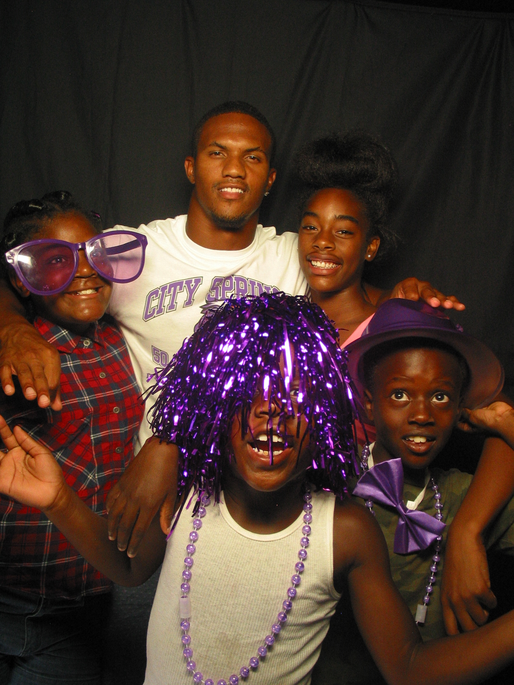 City Springs' birthday celebration attendees enter the photo booth. The booth attracts the young and the young-at-heart.