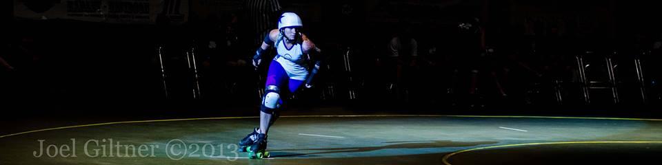 Corrie in her roller derby days - skating for Denver Roller Derby's Bruising Altitude