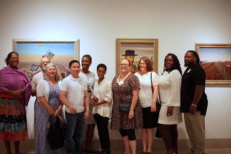 DMA Friends members with DMA Friends Community Manager (center left)  and Rae Pleasant (center) on exclusive curatorial tour.